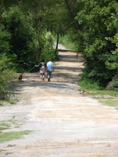 Couple with dog on trail